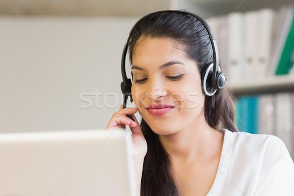 Call center representative using headset Stock photo © wavebreak_media