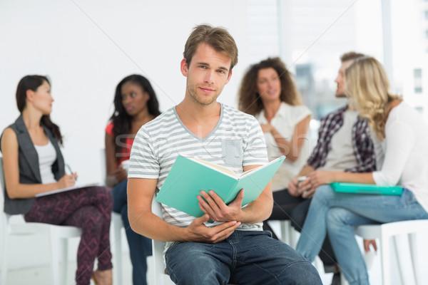 Feliz hombre cuaderno colegas hablar Foto stock © wavebreak_media