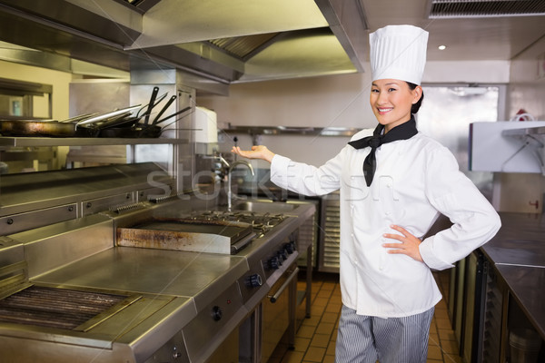 Kadın pişirmek mutfak portre ayakta restoran Stok fotoğraf © wavebreak_media