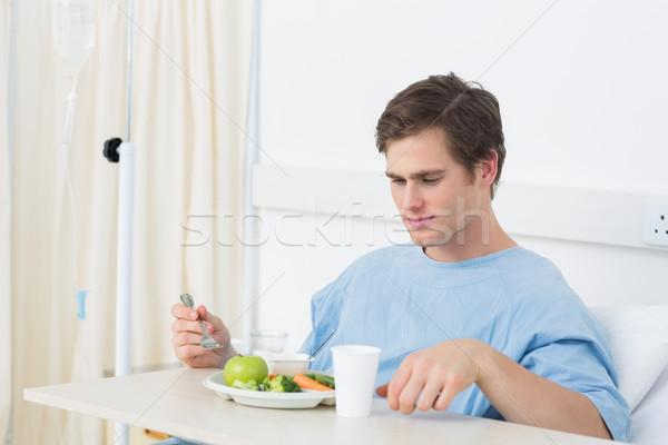 Patiënt maaltijd ziekenhuis jonge mannelijke eten Stockfoto © wavebreak_media