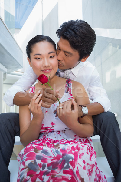 Man offering a red rose to girlfriend Stock photo © wavebreak_media