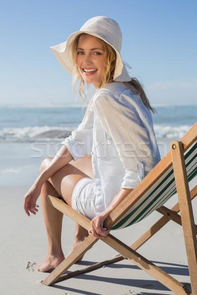 улыбаясь блондинка расслабляющая палуба Председатель морем Сток-фото © wavebreak_media
