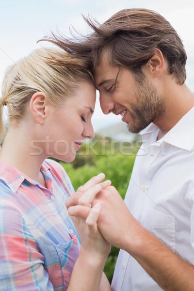 Aranyos szeretetteljes pár áll kívül kéz a kézben Stock fotó © wavebreak_media