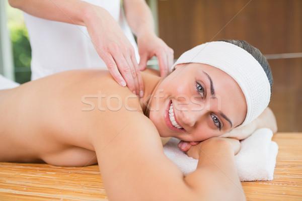 Smiling woman getting a back massage Stock photo © wavebreak_media