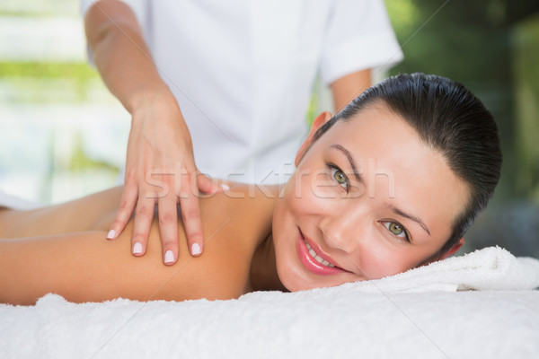 Inhoud brunette Maakt een reservekopie massage glimlachend camera Stockfoto © wavebreak_media