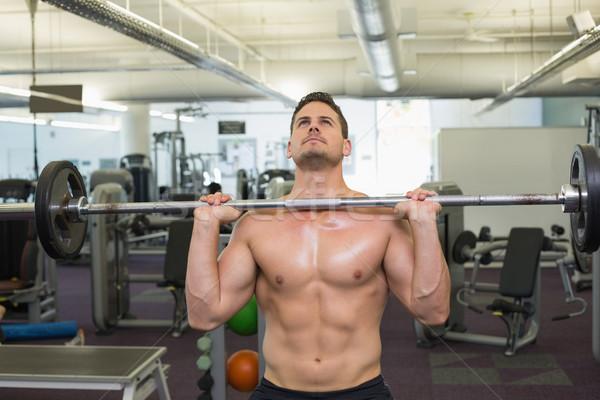 A torso nudo bodybuilder pesante bilanciere peso Foto d'archivio © wavebreak_media