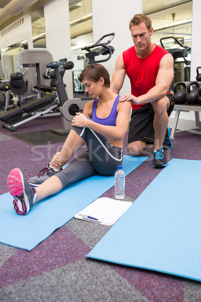 Personal trainer rubbing clients shoulders on mat Stock photo © wavebreak_media