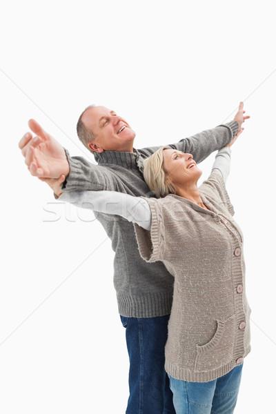 Happy mature couple in winter clothes Stock photo © wavebreak_media