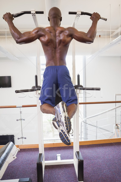 Male body builder doing pull ups at gym Stock photo © wavebreak_media