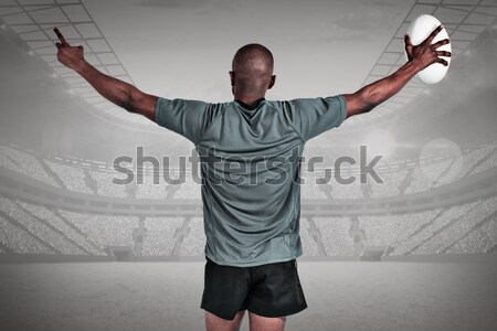 Rear view of athletic football player cheering Stock photo © wavebreak_media
