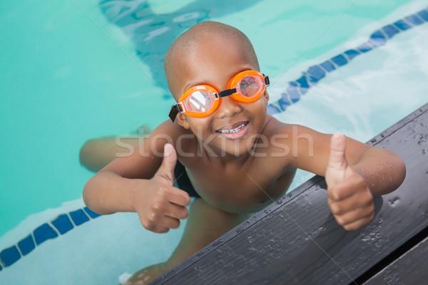 Cute мало мальчика бассейна отдыха Сток-фото © wavebreak_media