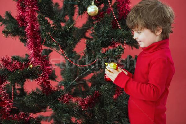 ünnepi kicsi fiú akasztás csecsebecse piros Stock fotó © wavebreak_media
