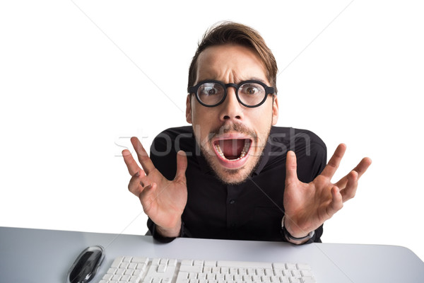 Worried businessman with glasses using computer  Stock photo © wavebreak_media