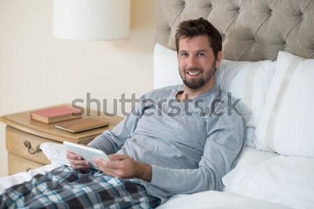Boldog férfi padló laptopot használ új otthon számítógép Stock fotó © wavebreak_media