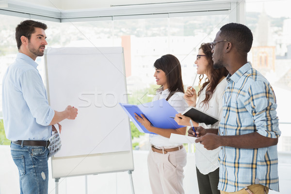 Man presenting and coworkers taking notes Stock photo © wavebreak_media