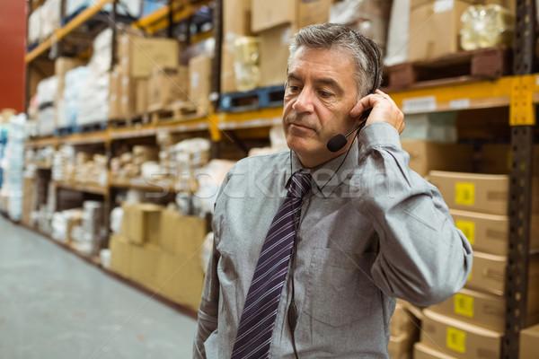 Gericht manager praten hoofdtelefoon groot magazijn Stockfoto © wavebreak_media