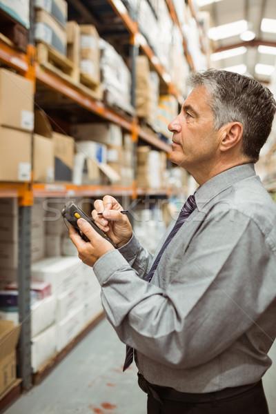 Focused male manager using handheld Stock photo © wavebreak_media