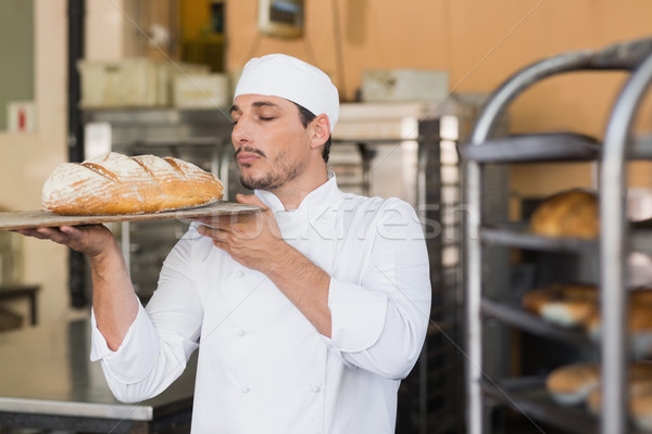 Baker smelling a freshly baked loaf Stock photo © wavebreak_media