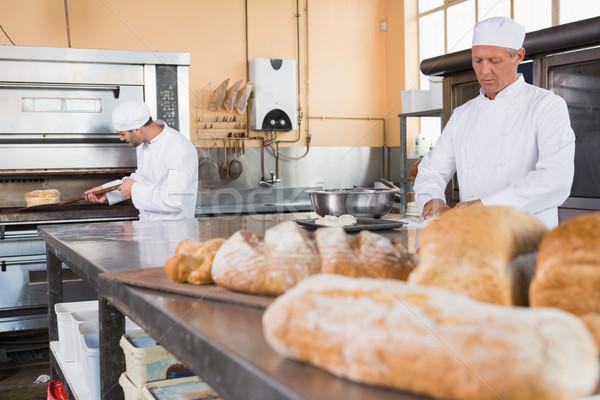 Baker making dough in mixing bowl Stock photo © wavebreak_media