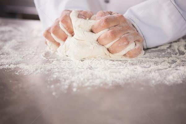 Close up of baker kneading dough on counter Stock photo © wavebreak_media