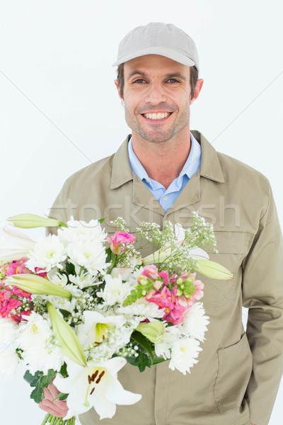 Feliz mensajero ramo retrato blanco Foto stock © wavebreak_media