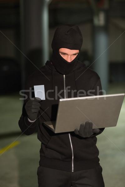 Hacker mit Laptop Identität Laptop Technologie Warenkorb Stock foto © wavebreak_media