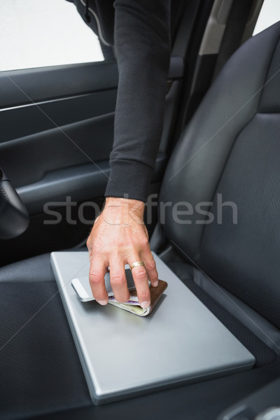Thief breaking into car and stealing Stock photo © wavebreak_media