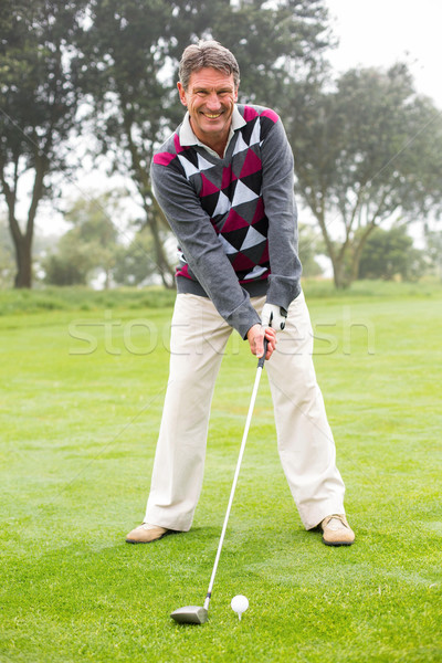 Golfer swinging his club on the course  Stock photo © wavebreak_media