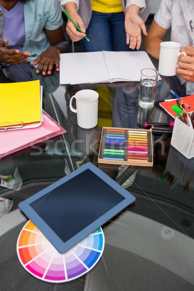 Colour samples and digitizer on desk Stock photo © wavebreak_media
