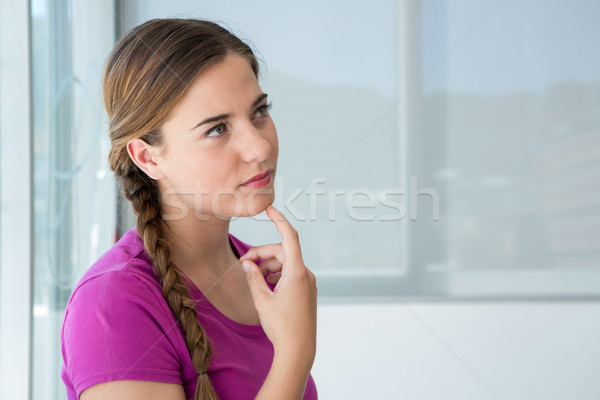 Thoughtful casual young woman Stock photo © wavebreak_media