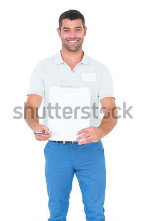 Futár vágólap aláírás fehér portré boldog Stock fotó © wavebreak_media