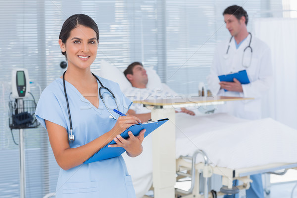 Stock photo: Doctors taking care of patient