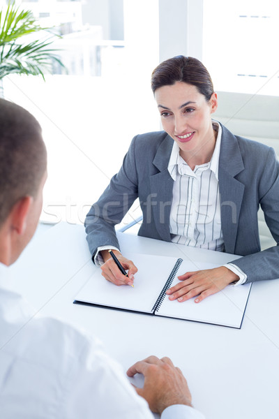 Businesswoman conducting an interview with businessman Stock photo © wavebreak_media