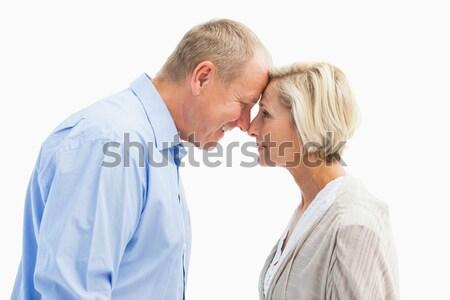 Businessman telling secret to a businesswoman Stock photo © wavebreak_media