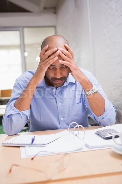 Cansado empresário papelada secretária jovem mesa de escritório Foto stock © wavebreak_media