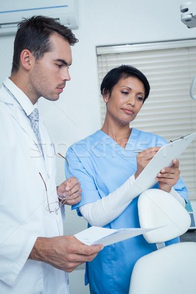 Dentists discussing reports Stock photo © wavebreak_media