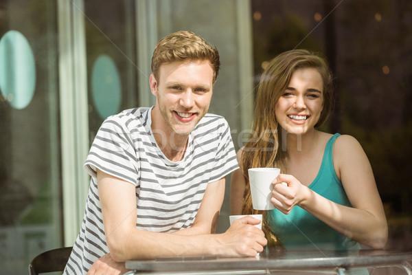 Sorridere amici mug caffè cafe Foto d'archivio © wavebreak_media