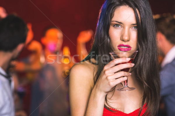 Drunk brunette looking at camera Stock photo © wavebreak_media