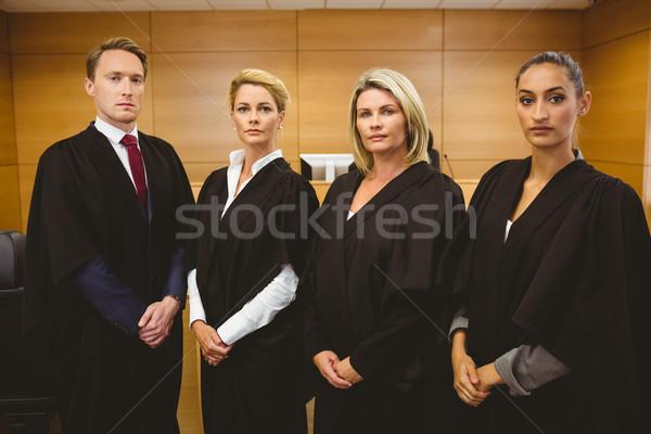 Quattro grave piedi indossare giudice stanza Foto d'archivio © wavebreak_media