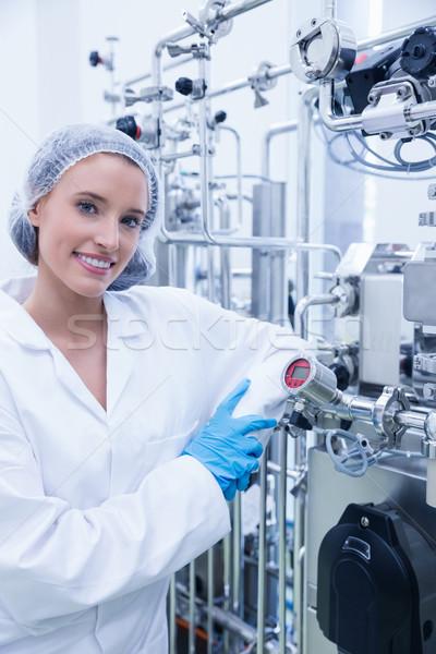 Mosolyog tudós dől kaliber gyár boldog Stock fotó © wavebreak_media