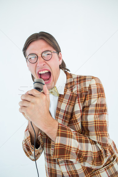 Happy geeky hipster singing with microphone  Stock photo © wavebreak_media