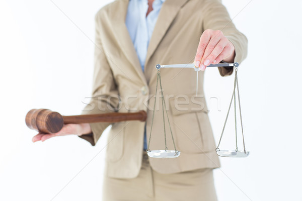 Young woman holding scales of justice and a gavel  Stock photo © wavebreak_media