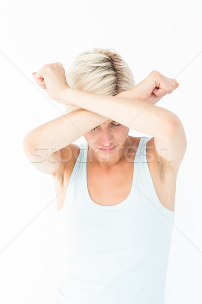 Upset woman holding her arms in front of her head Stock photo © wavebreak_media