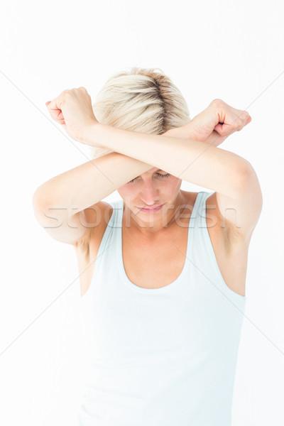Sconvolto donna braccia testa femminile Foto d'archivio © wavebreak_media