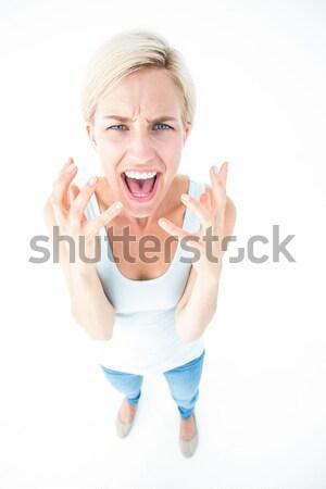 Upset woman yelling with hands up  Stock photo © wavebreak_media
