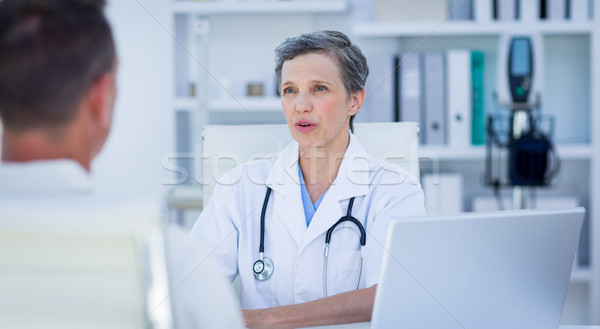 Female doctor speaking with her patient  Stock photo © wavebreak_media