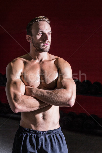 Muscular man with arms crossed Stock photo © wavebreak_media