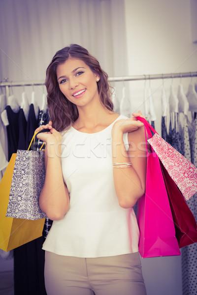 Retrato mujer sonriente mirando cámara boutique Foto stock © wavebreak_media