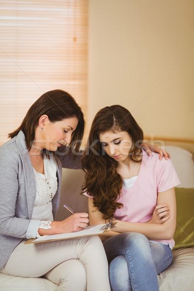 Therapist listening to her upset patient Stock photo © wavebreak_media