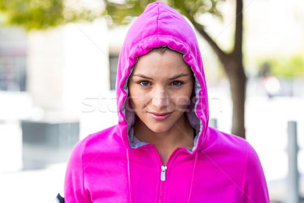 Kadın pembe ceket şehir Stok fotoğraf © wavebreak_media